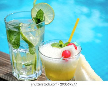 Two summer cocktails on a pool side