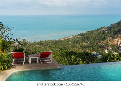 two sun loungers by the sea near the pool in Thailand