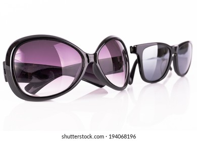 Two sunglasses isolated on white