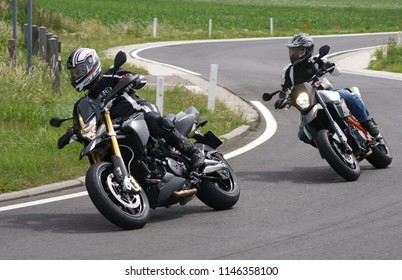 Two supermotard motorcycles on windy roads close to Waremme, liege area/Belgium - June 17 - 2011