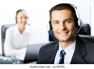 Two support phone operators at workplace