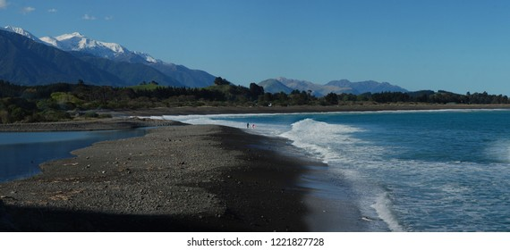 Two Surfers Heading Out, Kaikoura, South Island, New Zealand