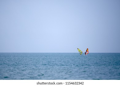 Two surfers on the sea in summer background
