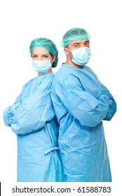 Two surgeons  in sterile uniforms standing back to back with arms folded and looking camera isolated on white background