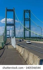 Two suspension bridges known as the Narrows Bridge in Tacoma, Washington.