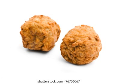 Two Swedish meatballs on a white background