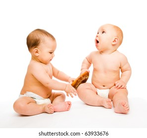 Two sweet babies in diapers with a roll