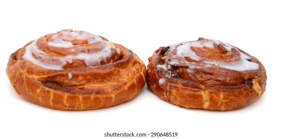 two sweet breads on white background