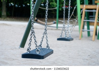 two swings on childrens playground