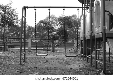 Two swings at the public playground black and white photo. Nobody,  Lonely concept.
