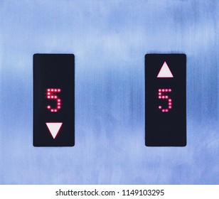 Two symbols of lift shows choice to go up or down