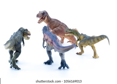 Two t rex and allosaurus attacking another isolated in white