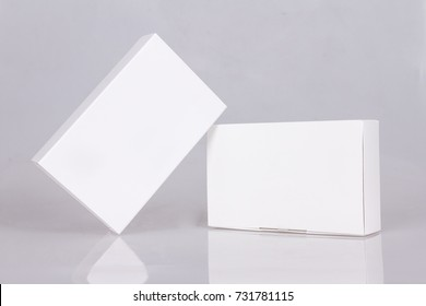 Two tall white boxes. Mockup ready for your design. Box perspective. Box template. Box empty blank.