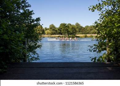 Two Teams Of Rowers Racing On River Thames In Henley On Thames In Oxfordshire UK