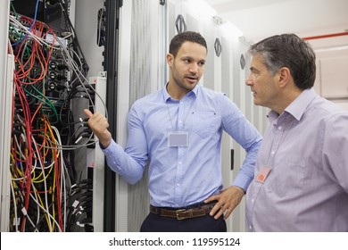 Two technicians discussing wiring in data center