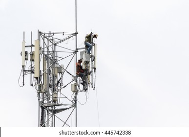 Two technicians working on  communication towers