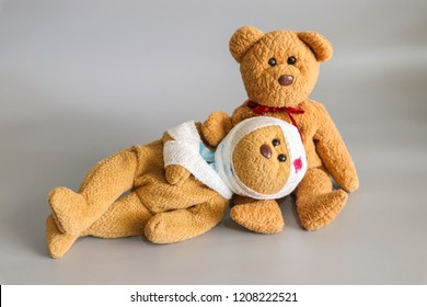 Two teddy bear with bandage on gray background,couples love be care when sickness,health care concept.