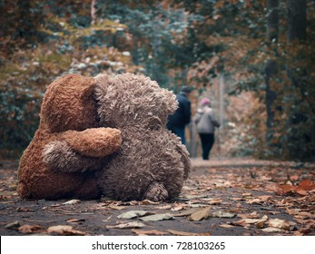 Two Teddy bear hugging each other and watch out for the road an elderly couple of people - grandparents