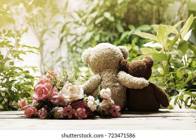 Two teddy bear sitting in nature vintage style