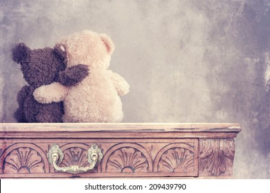 two teddy bears holding in one's arms