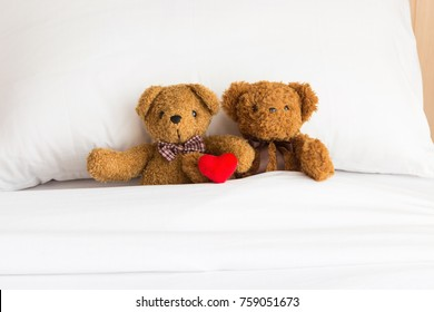 Two Teddy Bears lying on the bed. Love and relationship concept.