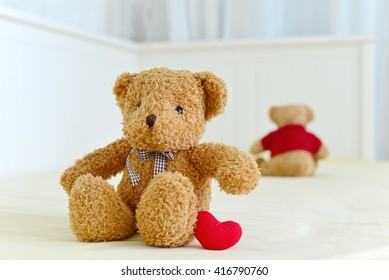 Two Teddy Bears sitting on the white bed. Concept about one-side love, difficult love and expectancy.