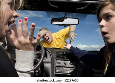Two teen girls not knowing what to do after hitting a man because they were distracted by eachother in their car.