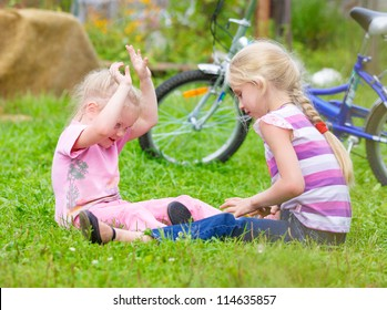 two teen girls playing on the grass