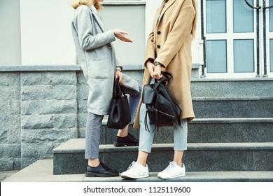 two teen girls in a street. stylish young women girlfriends