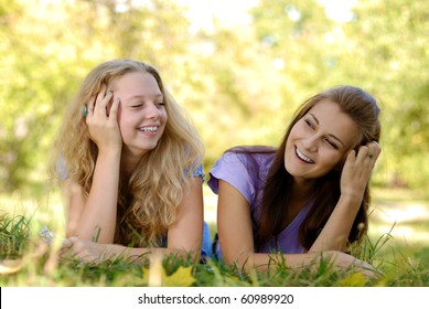 Two teenage girls having fun outdoors