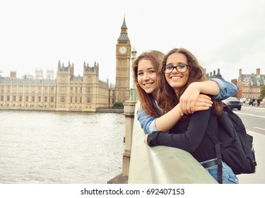 Two teenage girls on Big Ben background. London. Travel and tourism concept