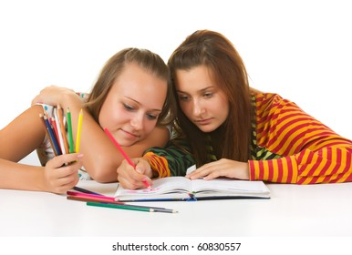 Two teenage girls  paint  isolated on white