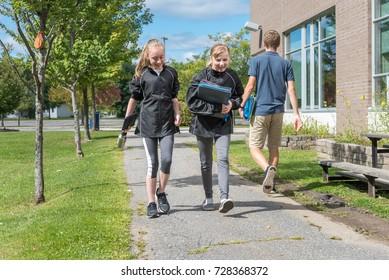 Two Teenage Girls walking to school, Canada.