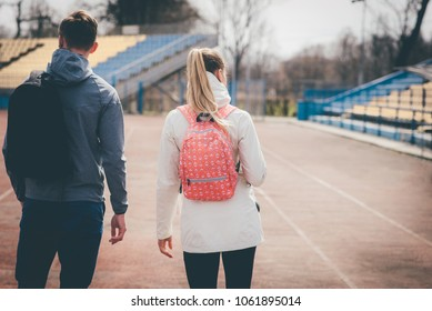 Two teenage students with backpacks ready for school. Two young sportsmans going to trainig.
