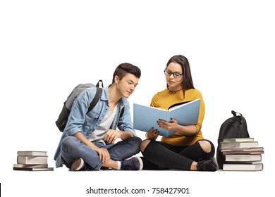 Two teenage students sitting on the floor and studying isolated on white background