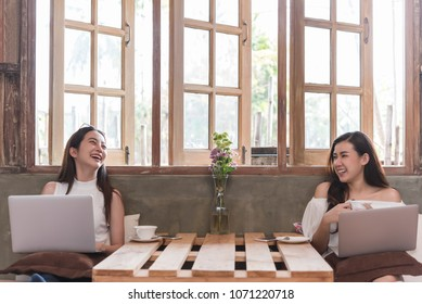 Two teenage women meet in coffee shop use laptop play social media have fun together in afternoon, life style of new teenager
