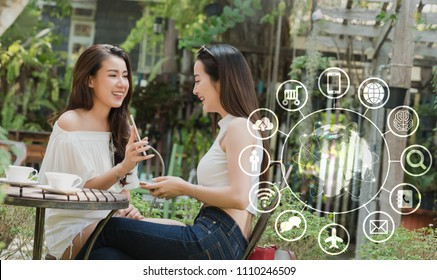 Two teenage women use smartphone with technology icon, internet of things conceptual