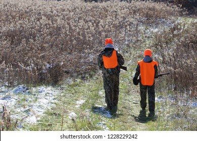Two teenagers deer hunting in the Midwest