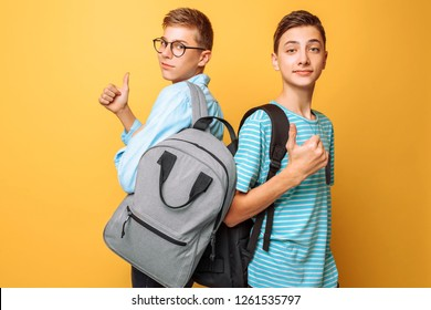 Two teenagers, guys show opposite emotions, friends show positive and negative gestures