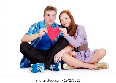 two teenagers with heart. Valentine day. Isolated on white background