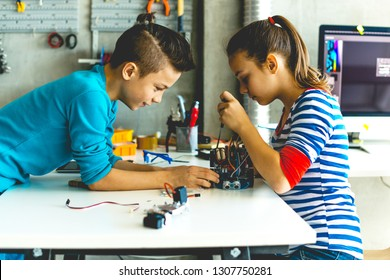 Two teenagers working on school assignment