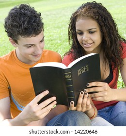 Two teens hang out in a park and read a bible