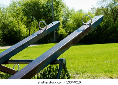 Two teeter totters saturated with color, shot in a playground