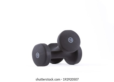 Two ten pound weights on white background