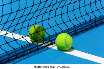 Two tennis balls on court