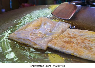 two thai banana pancakes fring in some clarified butter