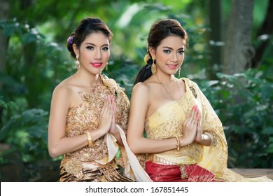 Two Thai woman wearing typical Thai dress, identity culture of Thailand