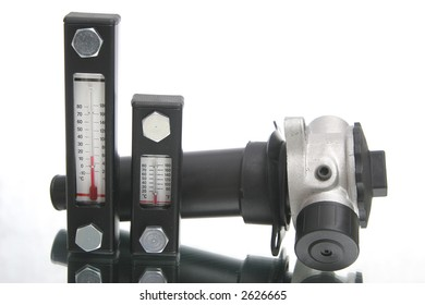 Two thermometers and metal element