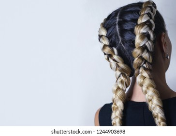 two thick braids of artificial hair, hairstyle youth, colored ha