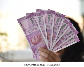 Two thousand indian rupee in background, New currency introduced to curb Black Money